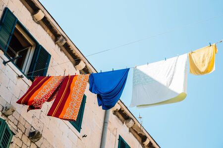 Washed laundry hanging on rope at old town in Split, Croatia 스톡 콘텐츠 - 131958019