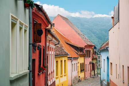 Sighisoara old town street colorful houses in Romania