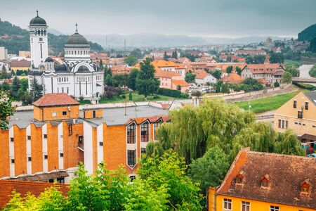 The Holy Trinity Orthodox Cathedral and Sighisoara old town panorama view in Romania Stock Photo