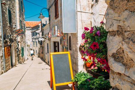 Primosten old town street at summer in Croatia
