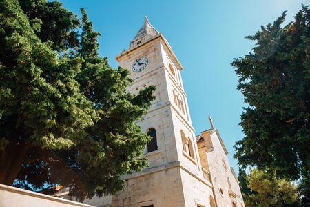 Saint George church on hill in Primosten, Croatia