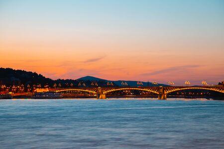 Sunset of Margaret Bridge on danube river in Budapest, Hungary