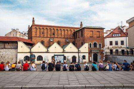 Krakow, Poland - June 15, 2019 : Old Synagogue and tourist people at Kazimierz district Jewish quarter