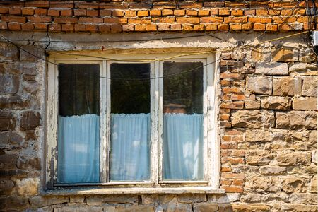 Old brick wall and glass window in Bulgaria 版權商用圖片