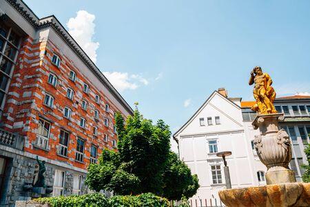 National and University Library of Slovenia and Fountain of Neptune in Ljubljana, Slovenia