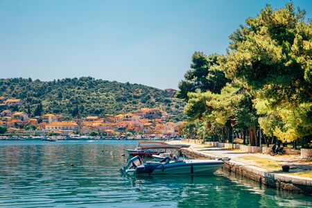 Adriatic sea and historic town Trogir at summer in Trogir, Croatia Stock Photo