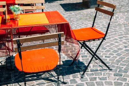 Empty restaurant terrace with table and chairs in Szentendre, Hungary