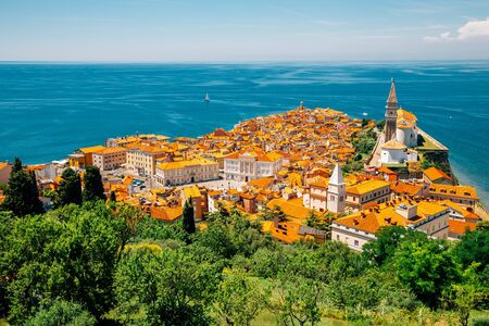 Panoramic view of Piran old town and Adriatic sea with St. George's Parish Church in Slovenia