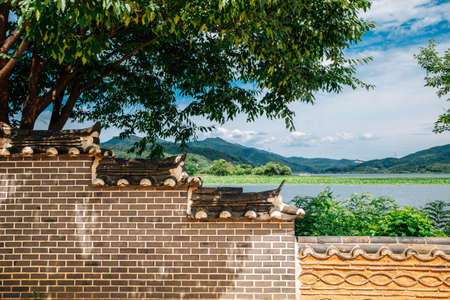 Korean traditional stone wall with river and mountain at Dumulmeori in Yangpyeong, Korea 스톡 콘텐츠 - 151335436