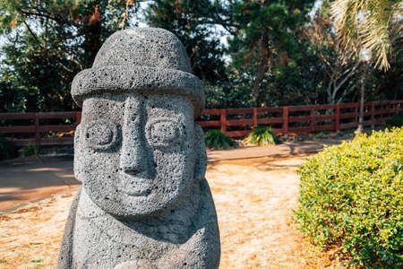 Dol hareubang stone grandpa sculpture at Daepo Jusangjeolli park in Jeju Island, Korea