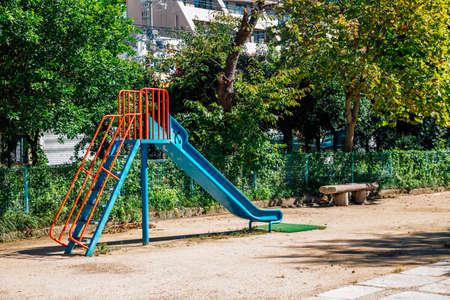 Children playground slide with green trees in Japan