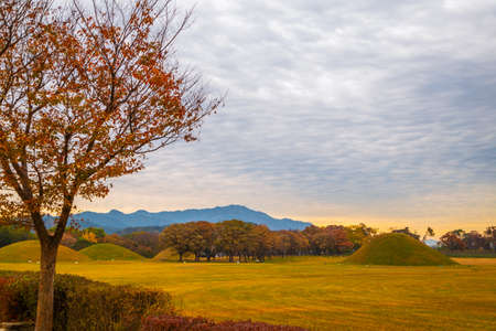 Sunset of Inwang-dong ancient tomb complex at autumn in Gyeongju, Korea