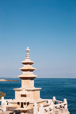 Stone tower with blue ocean at Haedong Yonggungsa Temple in Busan, Korea