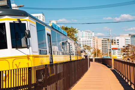 Busan, Korea-November 12, 2020: Haeundae Blue line park beach train 新闻类图片