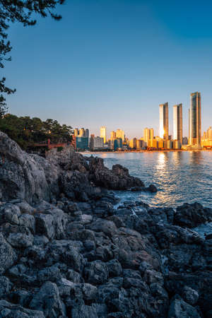 Haeundae beach and Dongbaekseom island at sunset in Busan, Korea