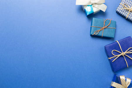 Blue gift boxes on blue background. top view, copy space