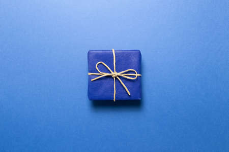 Blue gift box on blue background. top view