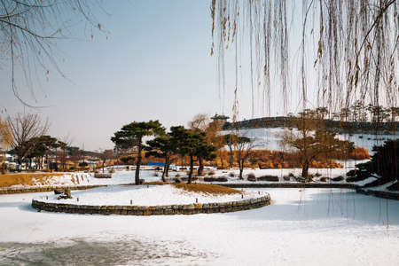 Hwaseong Fortress Banghwasuryujeong pond at winter in Suwon, Korea
