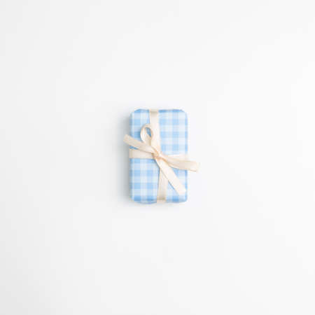 Blue check pattern gift box isolated on white background. top view, copy space