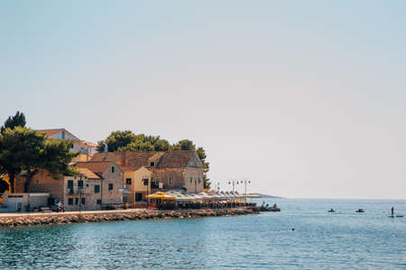 Primosten old town and adriatic beach in Croatia Stock Photo