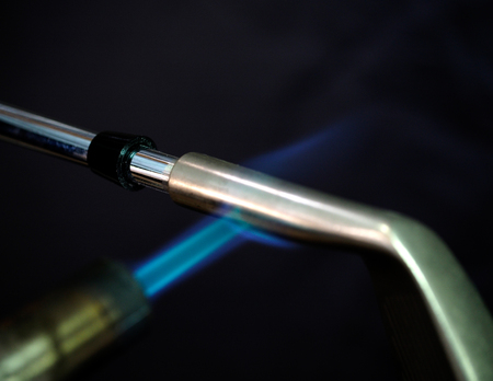 epoxy: Clubmaker use the butane torch to heat up and break epoxy before shaft remove.