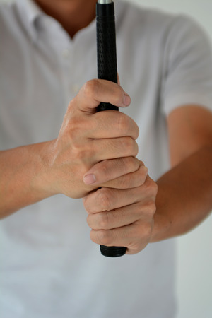 grip: Interlocking style golf grip Stock Photo