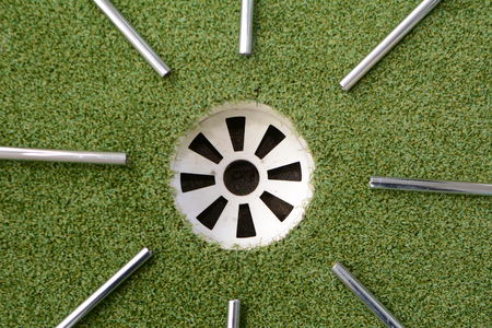 shafts: Steel golf shafts point to the hole