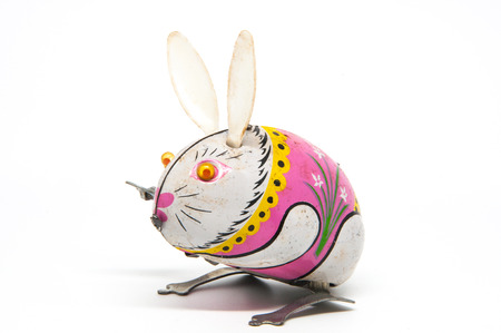 old metal: Tin toy rabbit isolated on white background