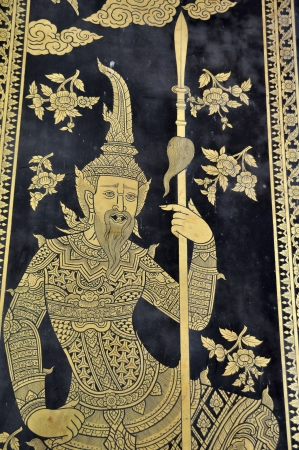 Traditional Thai style art painting on temples door photo