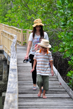 Mother and son at Bird Watching Trail in mangrove reforestation