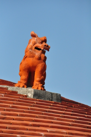 Red Shiasa  lion on the roof in  Okinawa,Japan