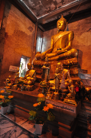 Golden Buddha statue inside the ancient temple of Wat Bang Kung , founded in 1707, at Amphawa Samut Songkhram, Thailand