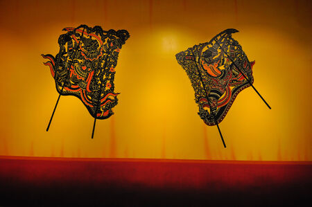 figuring: Shadow puppet  Nang Talung  was one form of public entertainment in the south of Thailand
