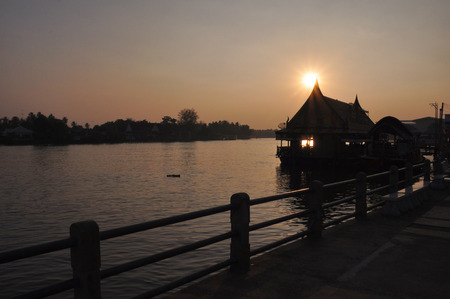 Sunset at Amphawa,Samut Songkhram,Thailand.Amphawa is one of the most famous floating markets in the world. photo