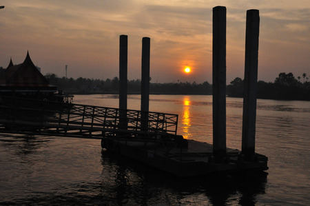sunrise at Amphawa,Samut Songkhram,Thailand.Amphawa is one of the most famous floating markets in the world. photo