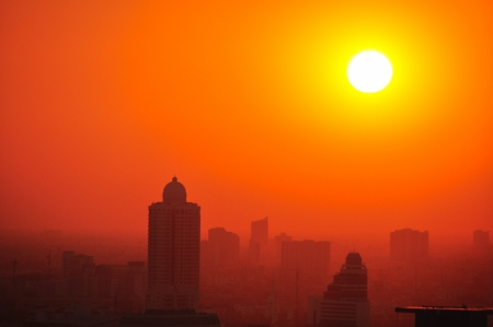 Sunset in the foggy day at Bangkok city, Thailand photo