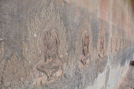 Beautiful dancing Apsaras an old Khmer art carvings on the wall in Angkor Wat temple , Cambodia photo