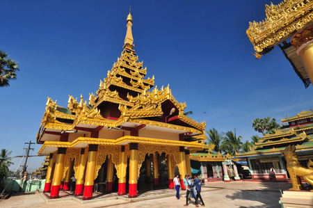 daw: Bago,,Myanmar - 28 November 2015: Unknown tourists visit the temple of Shwe Maw Daw Pagoda ,Bago,Myanmar.It is often referred to as the Golden God Temple