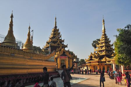 daw: Yangon,Myanmar - 28 November 2015: Unknown tourists visit Shwe Maw Daw Pagoda in Yangon,Myanmar.Part of the old pagoda was destroyed by an earthquake in 1917.