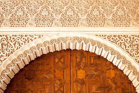 geometric and decorative figures on the walls of the buildings of the Alhambra in Granada, Andalusia, Spain