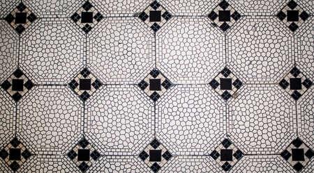 black and white mosaic geometric tiles in portugal Foto de archivo