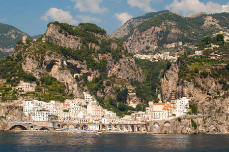 fishing and tourist village on the steep slopes of the Amalfi coast in Italy Фото со стока