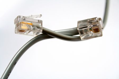 Two telephone cables with tips by diagonal Stock Photo