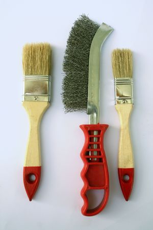 Two painting brushes and abrasive brush in the middle 1 photo