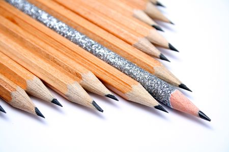 Celebratory pencil among usual pencils on a diagonal  4 Stock Photo