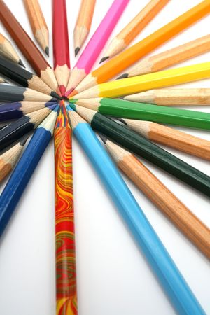 settled: Color and simple wooden pencils have settled down around of the multi-colour leader