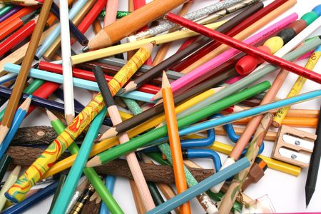 Collection of multi-colour wooden pencils and wooden sharpener Stock Photo