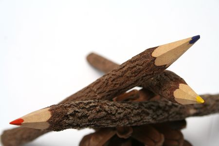 Heap of pencils made of a natural tree on a piny cone 2 photo