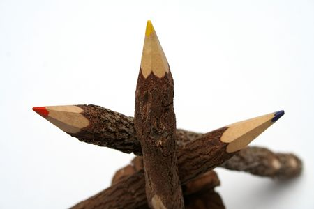 three pencils made of a natural tree on a piny cone 3 photo