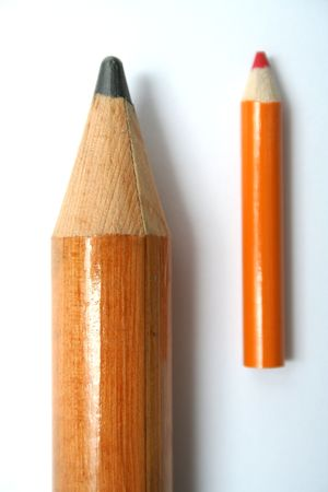 Small and big pencils laying beside in parallel 1